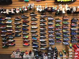 A wall of shoes in a shoe store