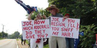 Biden, motorcade, protesters, signs, Kevin Jackson